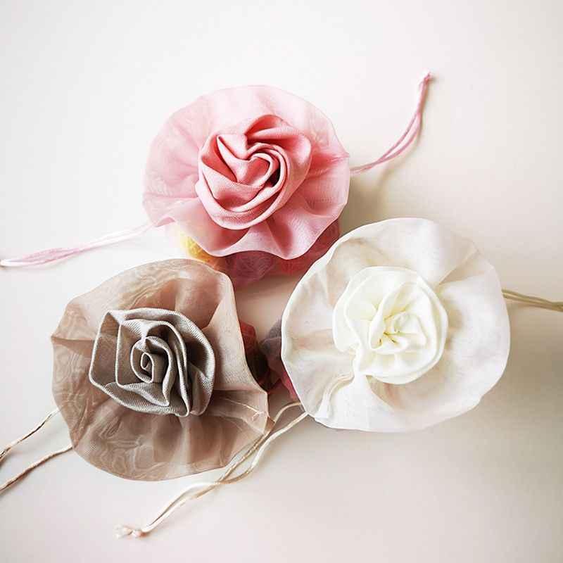 Bolsa de regalo creativa de tela con cordón trenzado para empaquetar dulces de boda