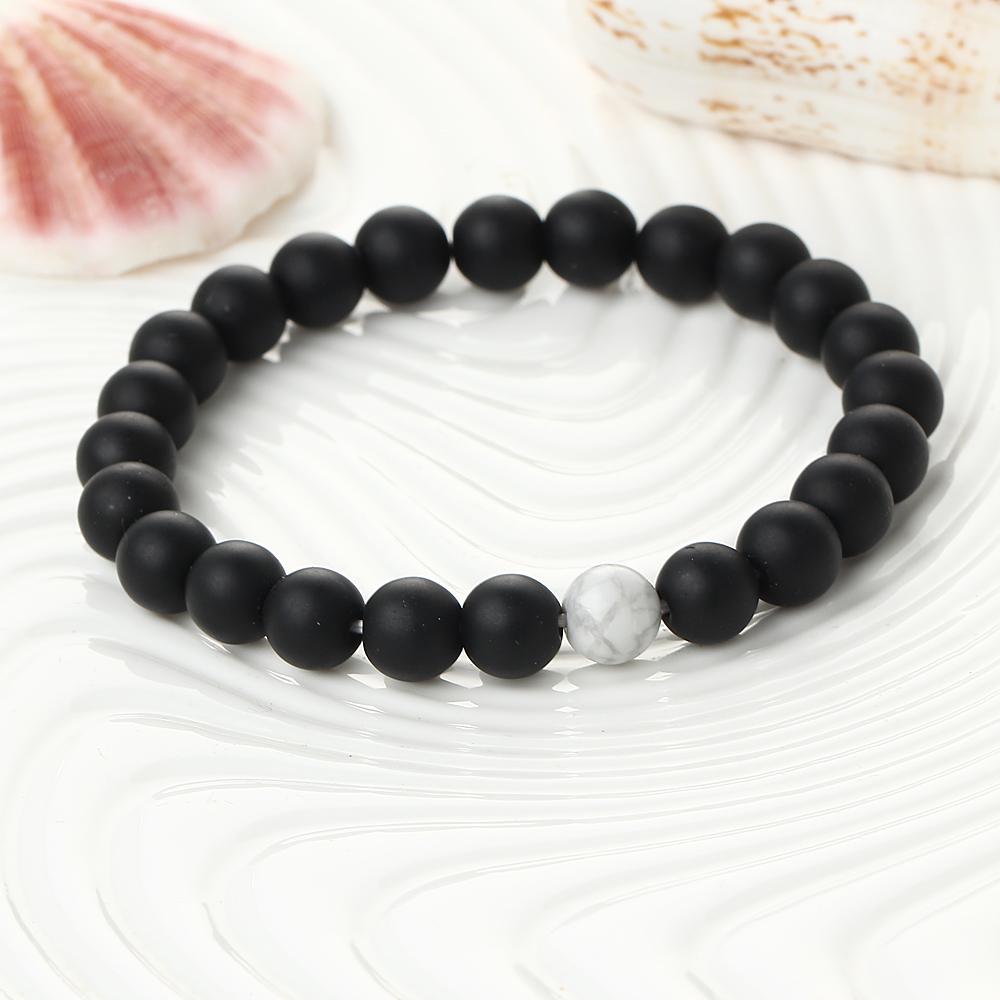Bracelet de perles noir et blanc en onyx et howlite blanche