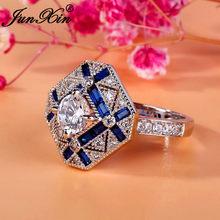 a6ba6f5540a4 Anillos grandes de geometría de lujo JUNXIN para hombres mujeres 925 Plata  de Ley llena azul blanco zirconio anillo de compromis.