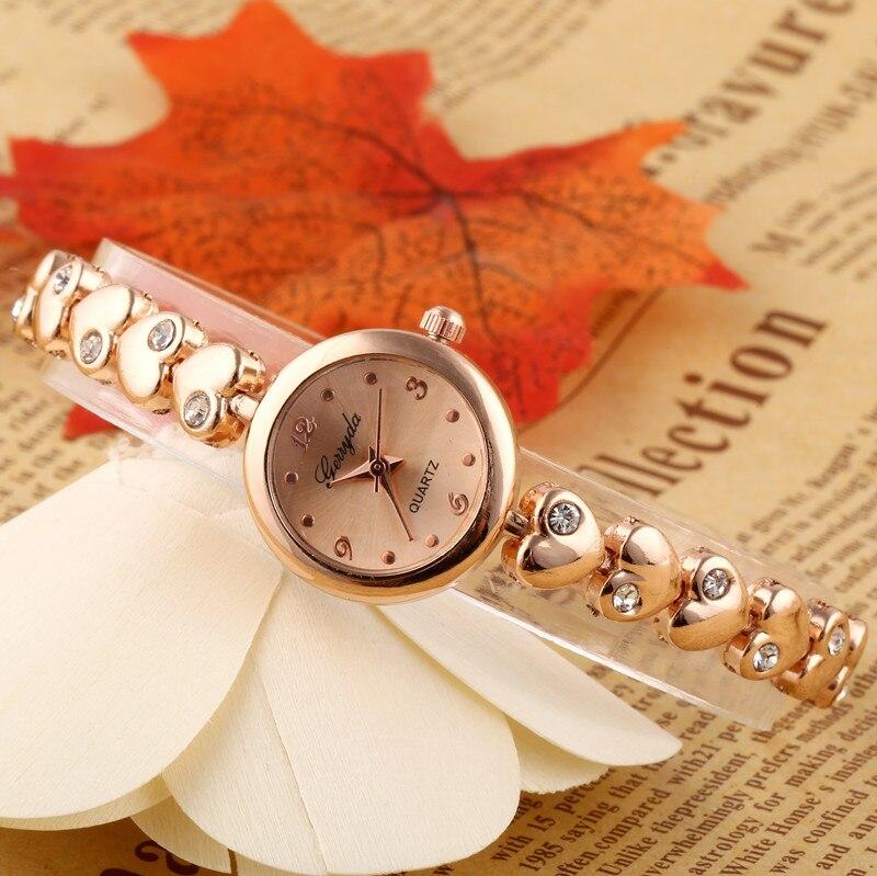 d8ed31162dbad Libérez le bateau! coeur en métal bracelet bande, or plaque boîtier rond,  simple cadran, mouvement à quartz, Gerryda mode femme chaîne en métal  montres