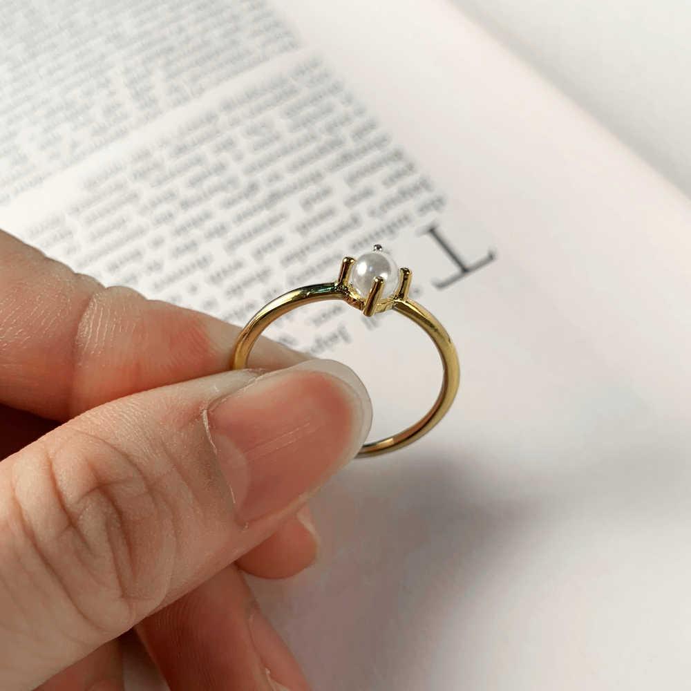 ZHOUYANG แหวนสำหรับ Women MINI Pearl แหวนบาง Minimalist สไตล์ Basic Light สีเหลืองทองแฟชั่นเครื่องประดับ KBR010