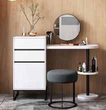 Simple baking varnish round mirror small family Internet celebrity dresser modern simple bedroom makeup cabinet.