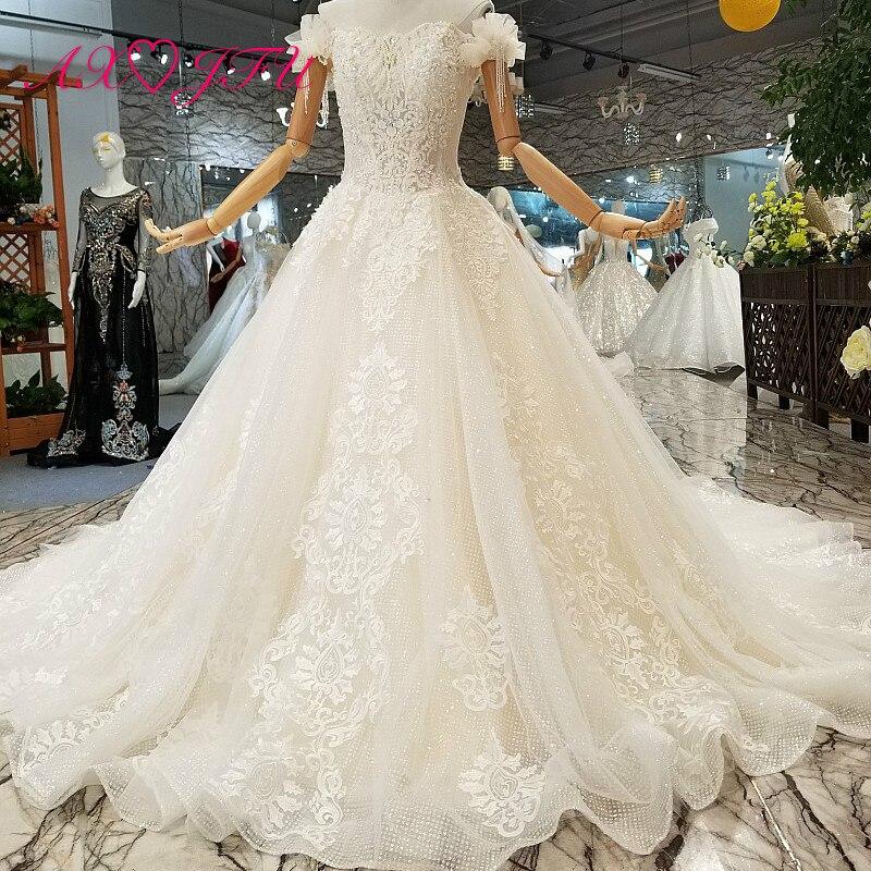 AXJFU Luxury princess boat neck beading flower lace wedding dress vintage bow pearls turkey wedding dress 100% real photo 841441