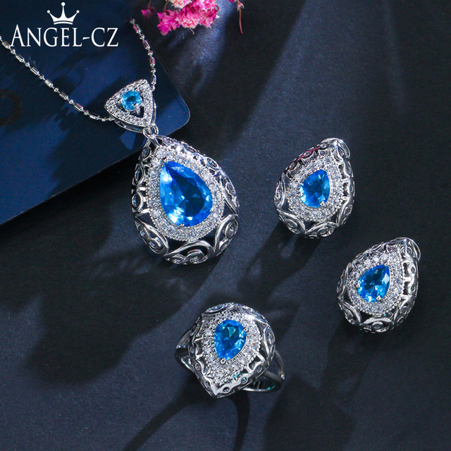 ANGELCZ 8 Color Options Sterling Silver 925 Ring Earrings Necklace Light  Blue Crystal Big Water Drop Women Jewelry Set AJ001 8f2e57d04da5