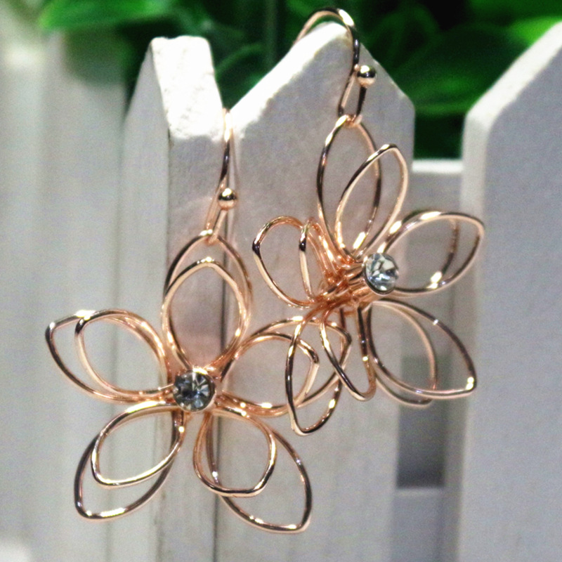 Japanese Korean version of the simple hollow flower metal temperament flower earrings ear hook earrings earrings