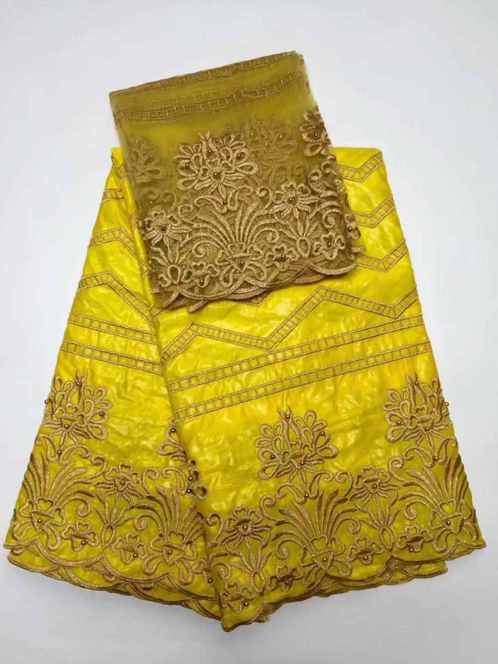 Yellow lace embroidered fabric bazin riche nigerian