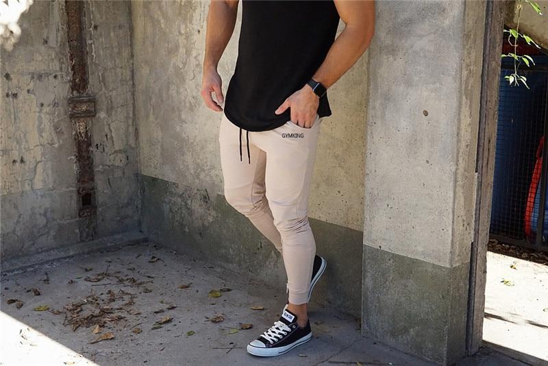 HTB1AzGhabr1gK0jSZFDq6z9yVXaG Fashion Mens Joggers Pants Skinny Casual Trousers Pants Top Quality Men Sweatpants