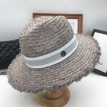 Primavera y verano nueva flash estándar grande gris aleros sombrero de paja  moda femenina Playa Mar sol sombrero 511840e4240
