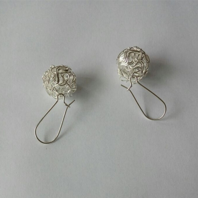Hot fashion earrings jewelry ornaments hollow silver ball ball earrings female j