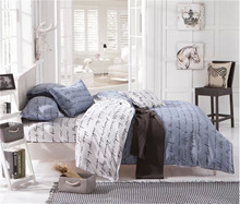 A set of three or four letters in white and grey English comforter bedding sets