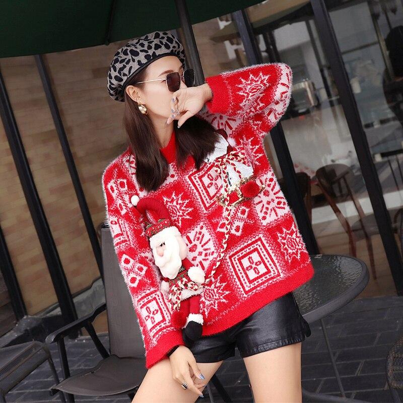 Czerwony świąteczny sweter z wystającym mikołajem w norweski wzór 2