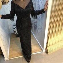 ブラックラグジュアリーセクシーなイブニングドレス2020スリムマーメイドタッセルビーズ長袖イブニングドレス女性のためのLA60716