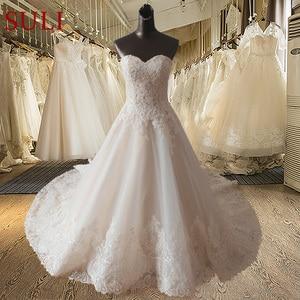 Image 5 - Vestido de novia SF1129, de muestra Real, corte en A, escote Corazón, apliques en el escote, vestidos de boda con dobladillo ancho