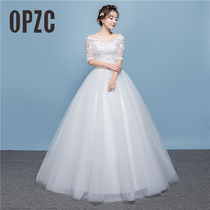 Real photo 2018 V Neck White Illusion Lace Wedding Dress Half Sleeve Backless Style with Delicacy Flowers Vestido De Noiva-in Wedding Dresses from Weddings & Events    1
