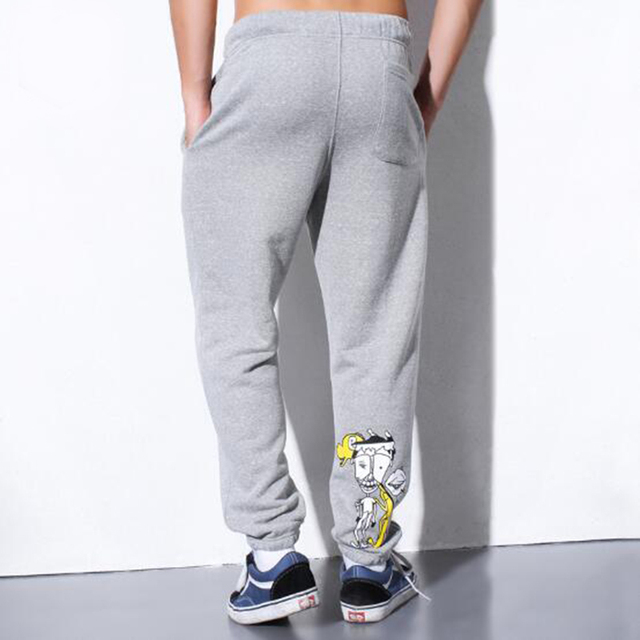 Soft loose diseño pantalones de los hombres de ocio de moda otoño invierno de algodón de dibujos animados de pie haz pantalones de chándal basculador