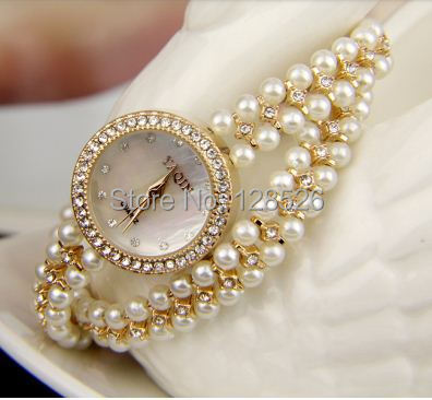 Women Rhinestone Watches 2014 Ladies Dress Watches Diamond Girls Luxury  Watches Female Butterfly Watch Pearl Rose Gold Watch01 -in Women s Watches  from ... 129b6b8f47