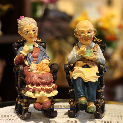 Grandpa and grandma rocking chair grandmother put a wedding souvenir on the table decorative pieces sculptures room