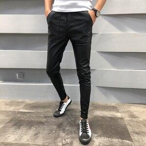 Image 1 - ¡Novedad! pantalones de cuero PU para hombre, pantalones de chándal informales ajustados para hombre, pantalones bombachos Hip Hop con cordón, pantalones bombachos para hombre 40