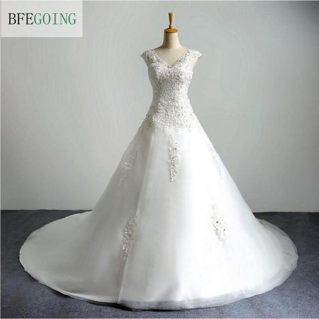 7956b1a808326 V-Neck Tulle Ivory Lace Appliques Sleeveless Floor-length A-line Wedding  dress
