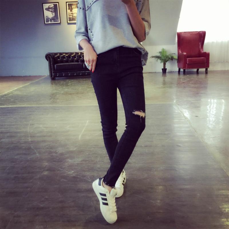 Original Women In Ripped Jeans  Xtellar Jeans