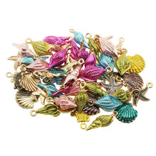 Exquisite ornaments 20pcs pieces of color alloy enamel mixed shell starfish conch jewelry pendant crafts discovery.Randomly send