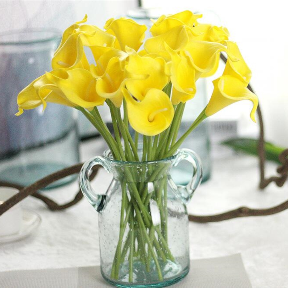 12pcslot artificial pu pretty flower bouquet yellow calla lily 12pcslot artificial pu pretty flower bouquet yellow calla lily flowers for wedding party home decoration free shipping in artificial dried flowers from izmirmasajfo
