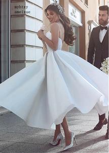 Image 1 - Backless Vestido De Noiva 2020 Cheap Wedding Dress Ball Gown Spaghetti Straps Satin Boho Dubai Arabic Wedding Gown Bridal