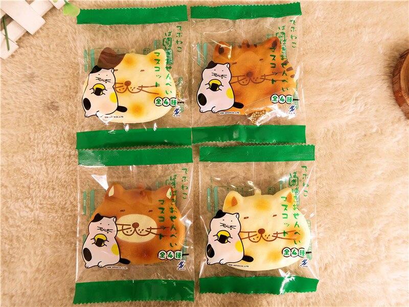 Kuutti Squishy Random 1 Piece Cute Japan Bendable Fussycat Chubby Cat Rice Cracker Metal Inside Brown / White Mobile Phone Strap