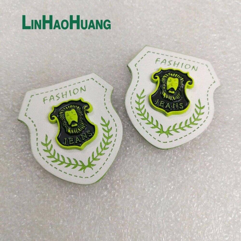 ツ)_/¯20 unids/lote blanco pu cuero coser con etiqueta verde y negro ...
