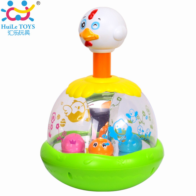 Original Huile Toys Cheap Baby Toys Push and Spin Carousel Chicken Toy Hen Jumping With Music Early Development Kawaii Kids Toys