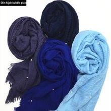3893fc078aa0 100 pcs de la peau des Femmes hijab perle bulle plaine Maxi écharpe châle de  mode musulman hijabs vente chaude foulards châles i.