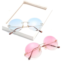 купить Round rimless metal Sunglasses Women Transparent Designer Two-tone Painted Summer Glasses UV400  DF17044 по цене 1511.04 рублей