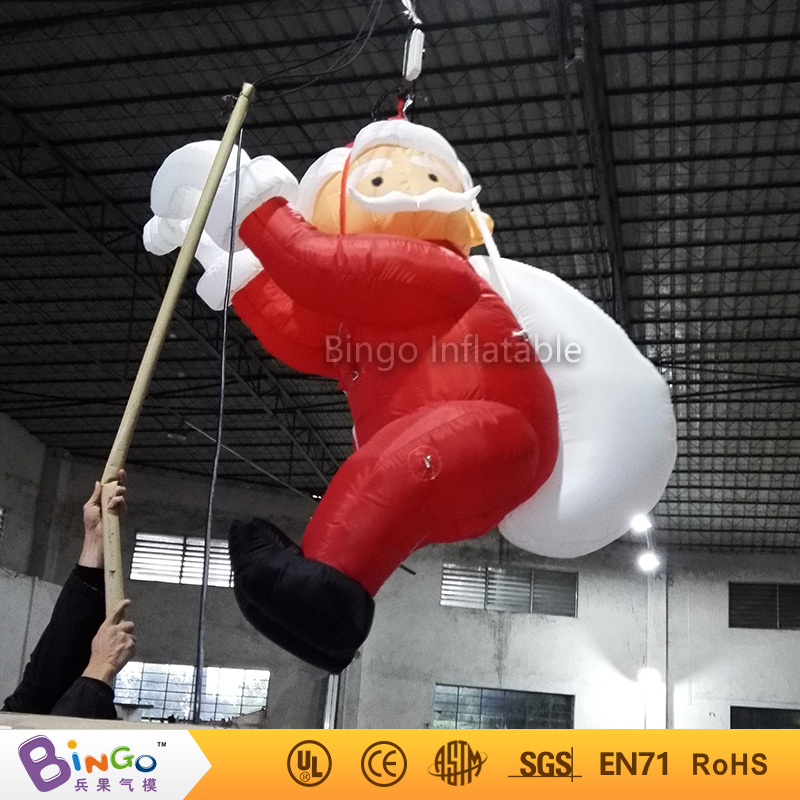 Outdoor Xmas inflatable life size toy father christmas on chimney inflatable cartoon customized advertising giant christmas inflatable santa claus for christmas outdoor decoration