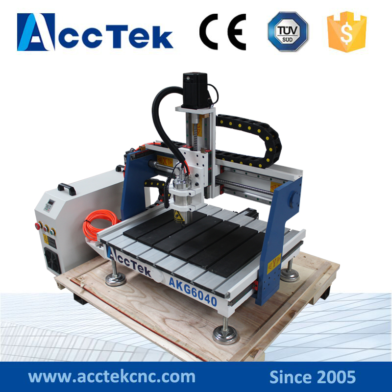 Jinan Acctek 1.5kw/2.2kw metal engraving router 3d cnc 6040 european quality jinan acctek high quality 4 axis cnc engraver wood router