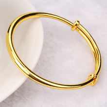 Гладкий детский браслет с желтым золотом диаметром 50 мм