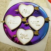 De creatieve keramische gerechten disc ring plaat ornamenten gilded Cupido hartvormige goud sieraden opslag disc