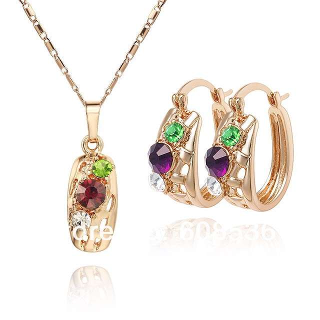 high quality. Free shipping wholesale - Gold plated CC color Rhinestone Crystal  jewelry set. Factory price. ss006