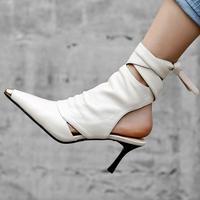 Однотонные женские туфли лодочки из натуральной кожи на высоком тонком каблуке с металлическим острым носком и шнуровкой на щиколотке, бос