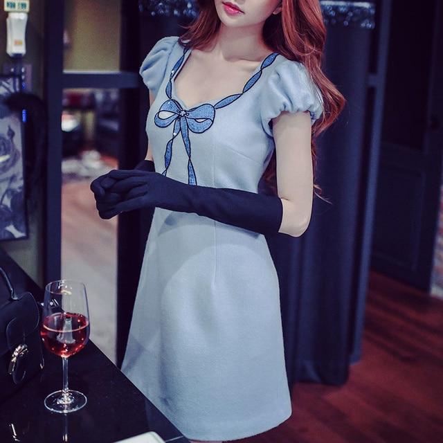 Blauwe wollen jurk