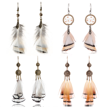 Купить с кэшбэком 2019 New Bohemian Natural Feather Earrings For Women  Vintage Boho Ethnic White Feather Drop Earring Fashion Jewelry Gifts