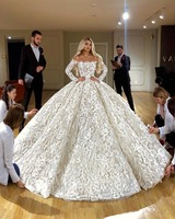Long Sleeve Lace Wedding Dress 2019 Puffy Ball Gown Beaded Feathers Boat Neck Arabic Dubai Style Bridal Dress Wedding Gowns