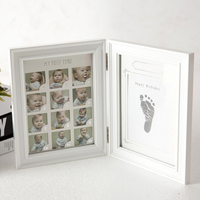 anniversary box full year old children, modern minimalist pendulum table, hanging wall, hand footprints, photo frame