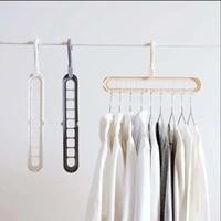 Wielofunkcyjny magiczny wiszący łańcuch metalowe ubrania wsparcie spinacze do prania kreatywny plastikowy szalik szafa koszule Tidy wieszaki zapisz w Osuszacze od Dom i ogród na