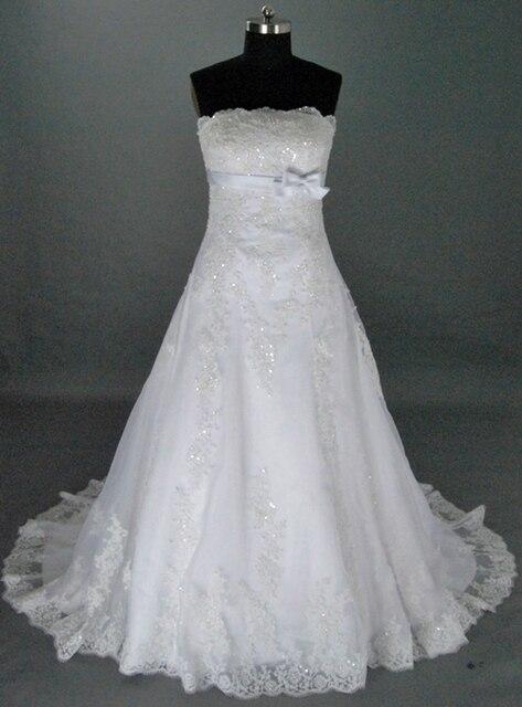 0fc3c5fbe الأنيق الديكور خط فساتين الزفاف الساخن بيع فساتين زفاف جديد تصميم اورجانزا  قطار فساتين للعرائس