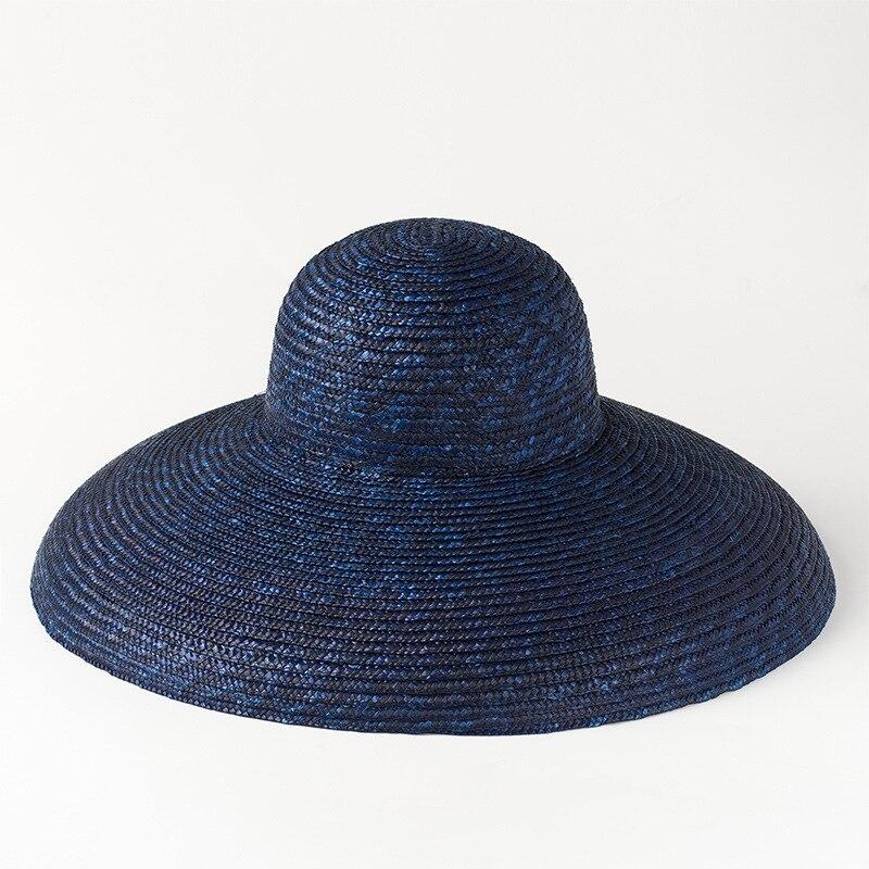 Playa sombrero Vintage de ala ancha sombrero de paja 2018 nuevo verano  sombreros de Sun para damas mujer sombrero de cubo de 681024 en Sombreros  de sol de ... 3e6c2688d92
