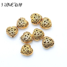 20pcs Antique Silver/Golden/Bronze Color Zinc Alloy Metal Heart Hollow Spacer Beads 14mm(China)