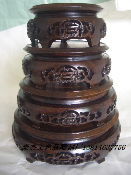 A Set Of Four Black Rosewood Wood Longevity Round Flower Vases African Blackwood Base Seat