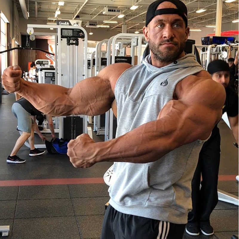 Terbaik Olahraga Menjalankan Rompi Tak Berlengan Kaus Pria Kebugaran Pakaian Tanktop Katun Pria Bodybuilding Kerja Rompi Joggers Gimnasium Undershirt
