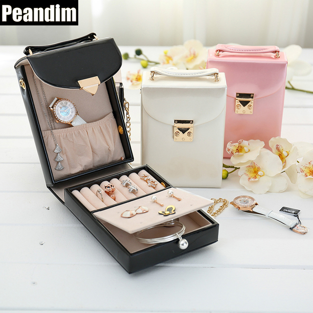 ae4a8690a218 US $20.29 30% OFF|PEANDIM 3 Colors Women's Jewelry Box Travel Cosmetics  Organizer Faux Leather Storage BOX Casket Container Hand Bag Makeup Box-in  ...