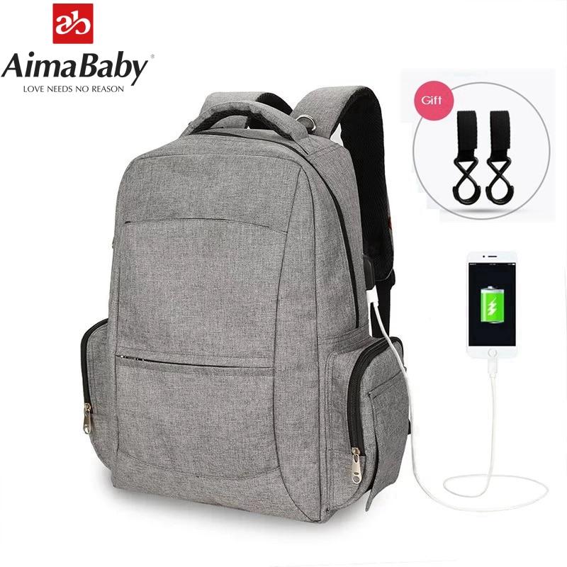 Mode USB-Lade Wickeltaschen Mutterschaft Babypflege Wickeltasche Marke Große Kapazität Trocken Nass Designer Reiserucksack Pflegetasche